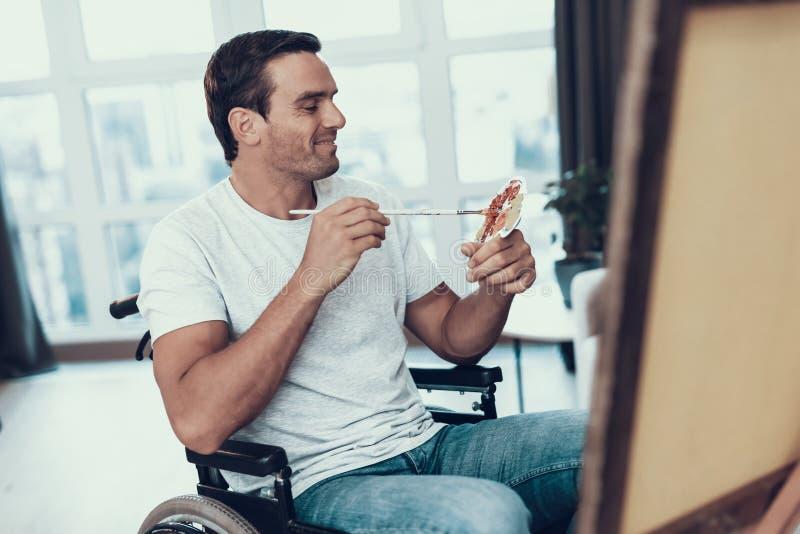 轮椅绘画图片的有残障的人 库存照片
