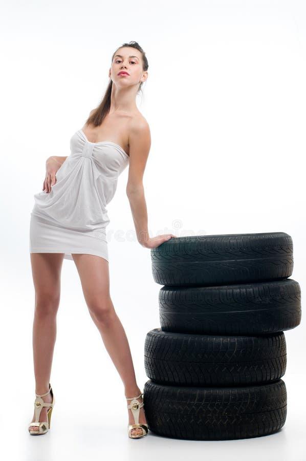 轮胎妇女 免版税图库摄影