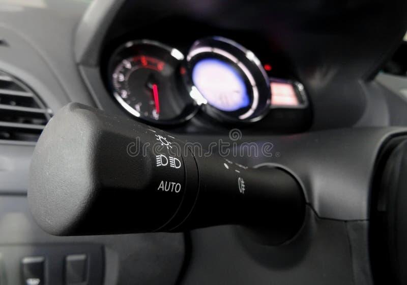 轮车灯开关和光在汽车内部的 库存照片