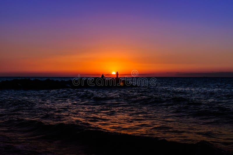 软的日落的渔夫 免版税库存图片
