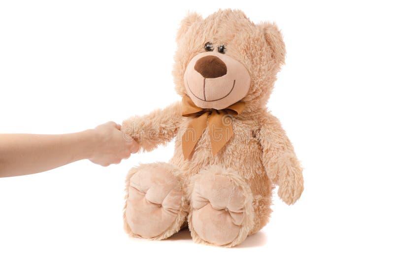 软的玩具米黄熊手 免版税库存照片