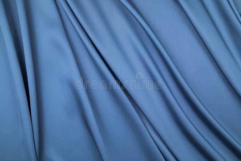 软的被装饰的折叠延长蓝色织品棉缎裁减  库存图片