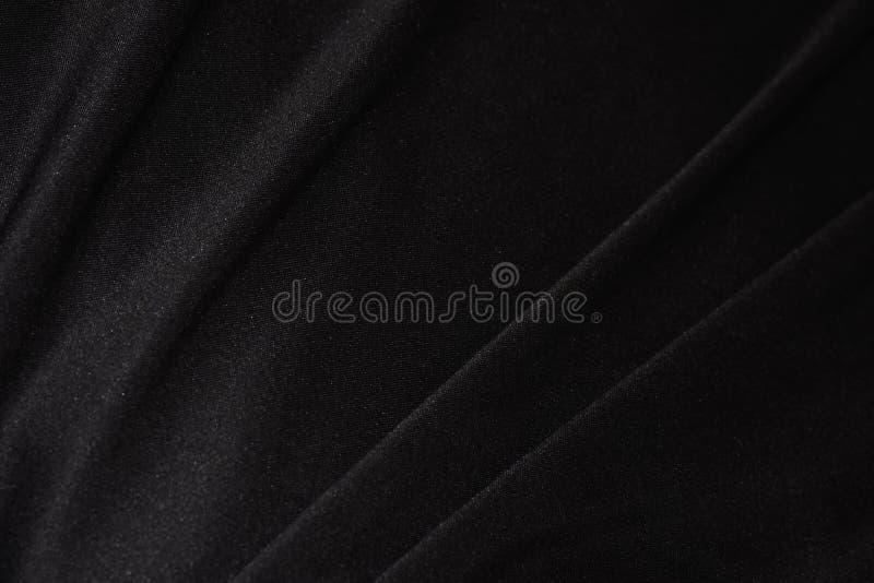 软的黑缎织品特写镜头 库存照片