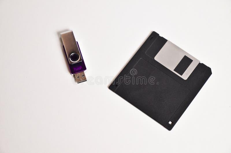 软盘磁盘和USB闪光驾驶记忆棍子 免版税图库摄影