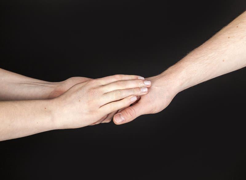 软软地接触两个的人的手 免版税库存图片