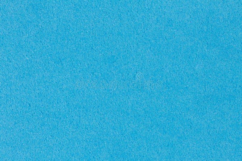 轻拍与简单的表面的蓝色泡沫伊娃纹理 免版税库存照片