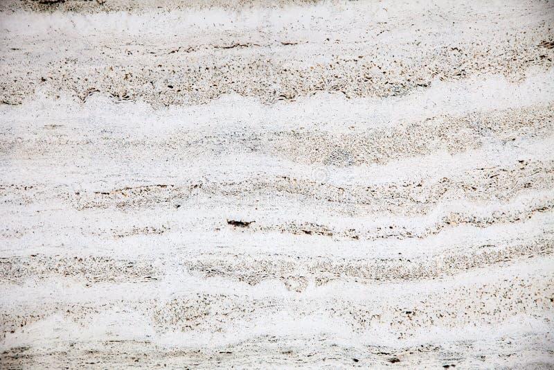轻混凝土墙壁的纹理有sturcturs的在黑色 免版税库存图片