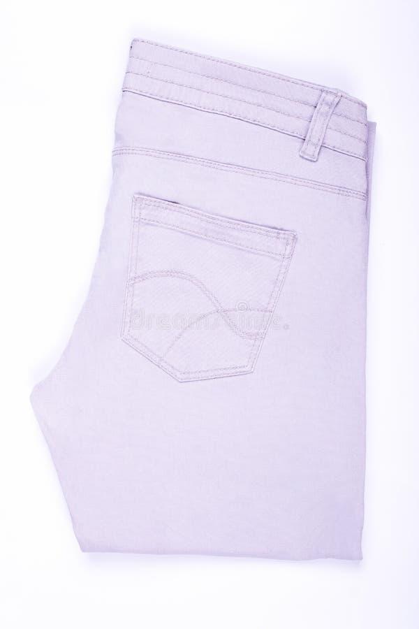 轻轻地被折叠的轻的牛仔裤孤立 免版税图库摄影