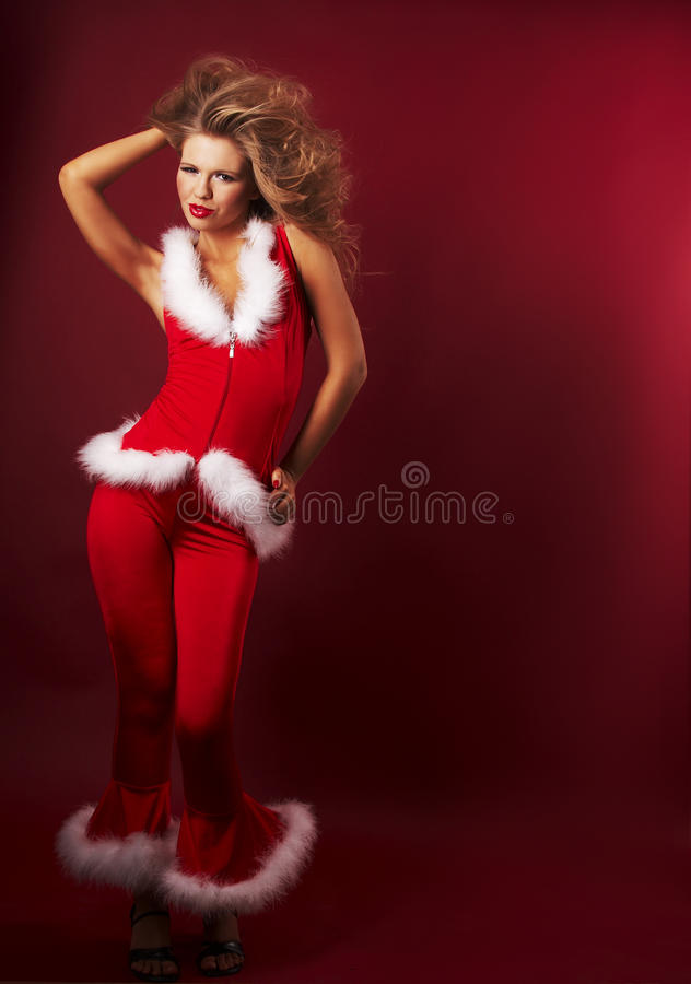 辅助工性感的圣诞老人 库存照片