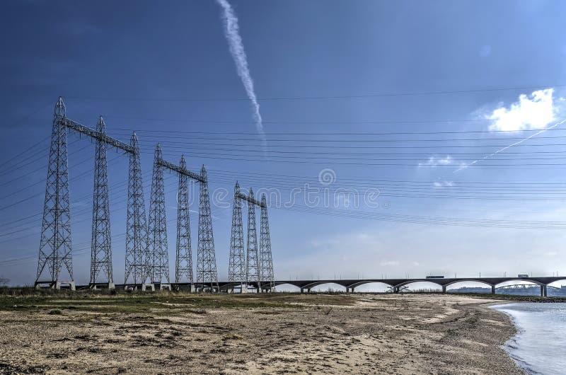 输电线在洪泛区 库存照片
