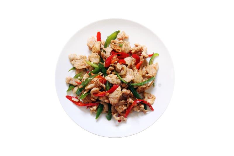 辣食物,辣椒食物,油煎了甜椒用猪肉、油煎的辣椒酱用猪肉,肉、咸猪肉与辣椒烹调用油& Basi 免版税库存照片