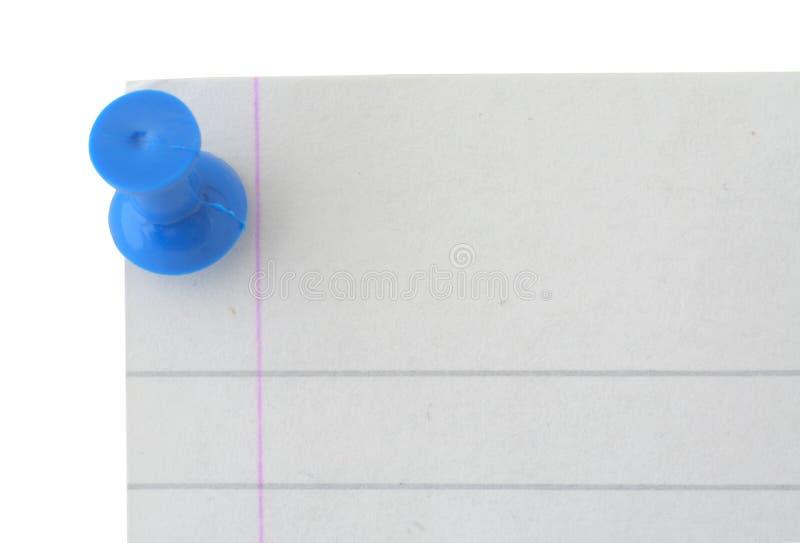 边缘被排行的纸针页 图库摄影