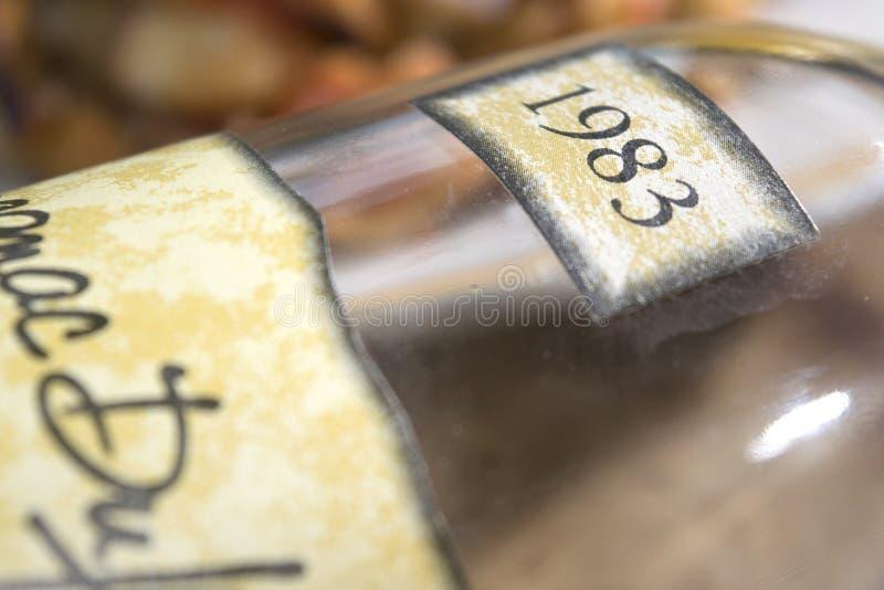 年迈的阿曼那白兰地的标签 免版税图库摄影