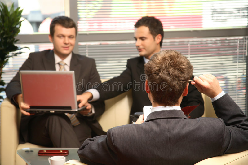 运作商人的办公室三 库存图片