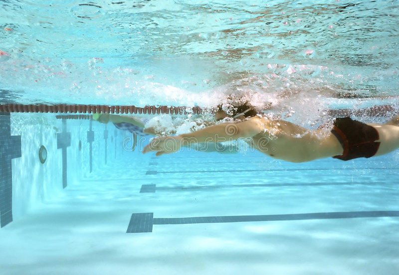 运作游泳 免版税库存图片