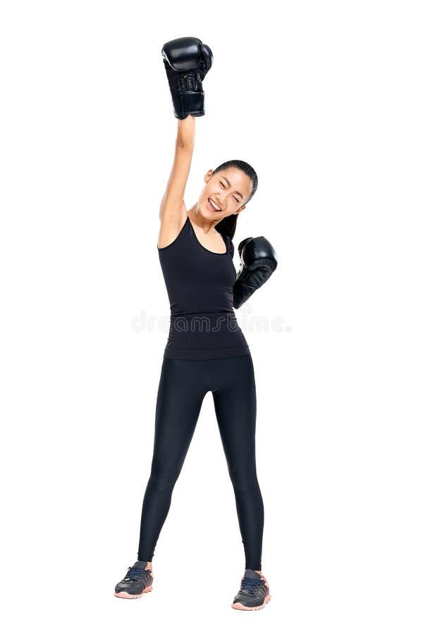 运动亚裔妇女画象拳击手套的递  免版税图库摄影