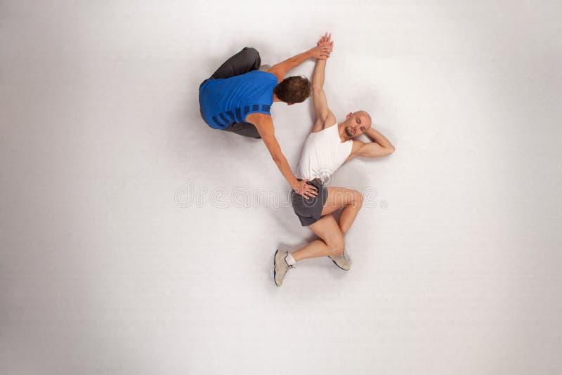运动人私有streching的培训人 库存照片