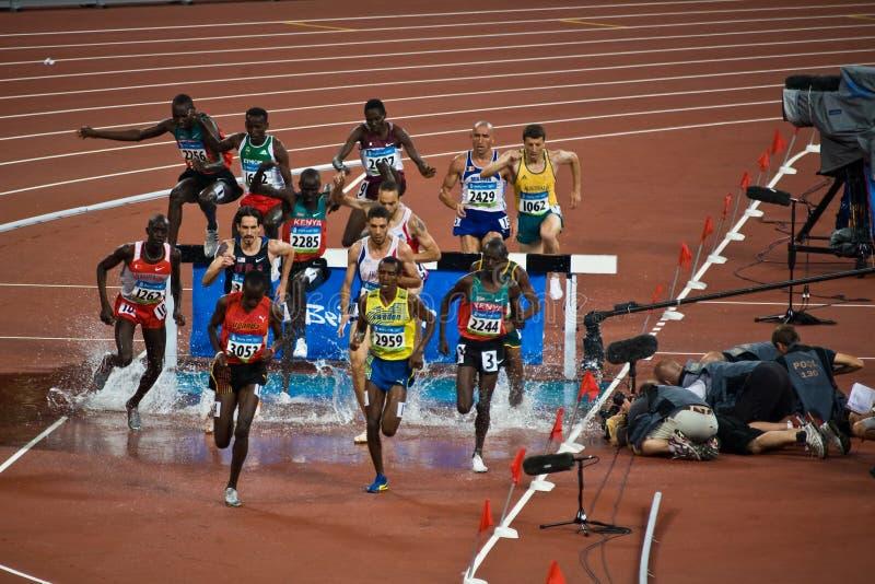 运动员奥林匹克运行中 免版税库存图片