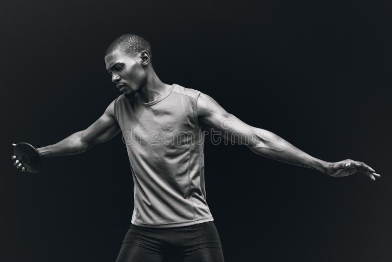 运动员实践的掷铁饼正面图的综合图象  库存图片