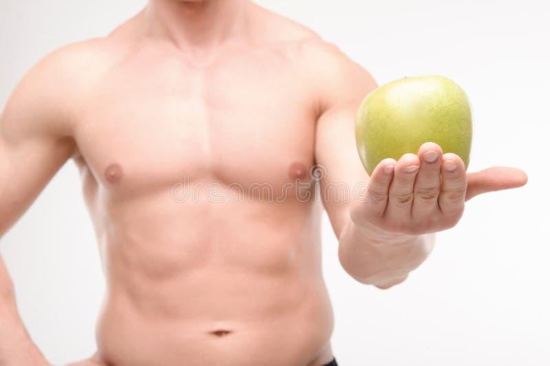 运动员用苹果 免版税库存图片