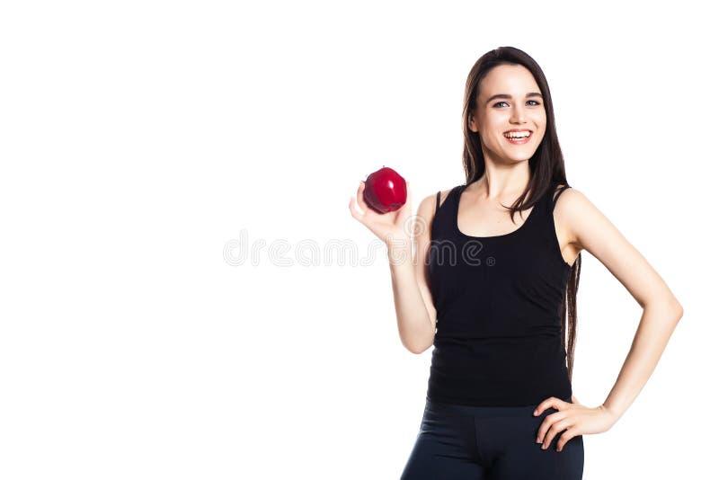 运动女孩用苹果 美好的白种人体育少妇,文本的空间画象  图库摄影
