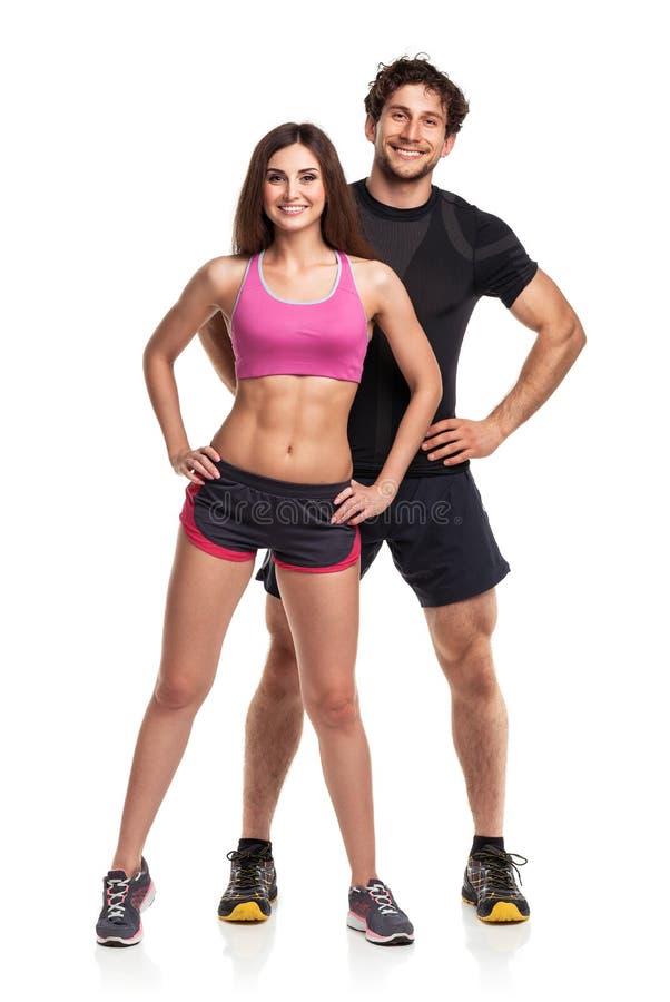运动男人和妇女在健身以后在白色后面行使 免版税图库摄影