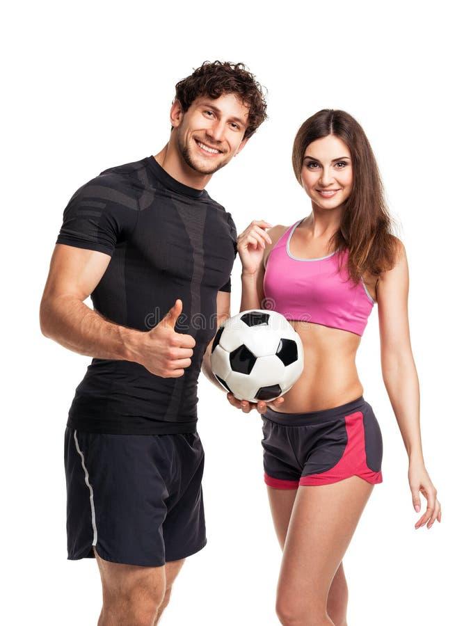 运动男人和妇女有球的在白色 免版税库存图片
