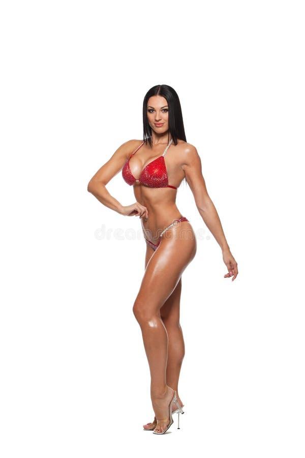 运动的妇女全长照片比基尼泳装的 免版税库存照片