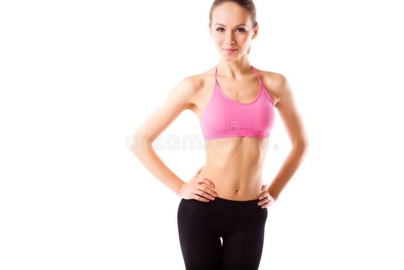 年轻运动的妇女,完善的被隔绝的适合女性身体细节的亭亭玉立的腰部  免版税库存图片