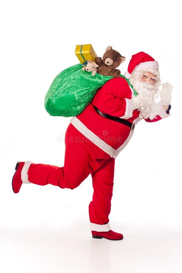 运行的圣诞老人 图库摄影