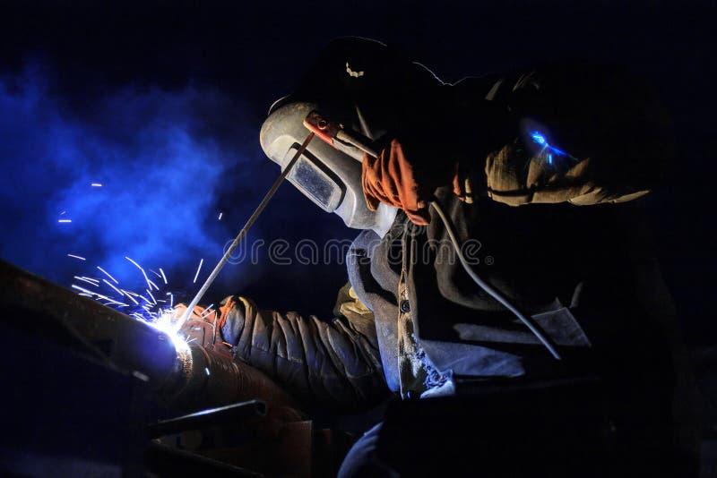 运转的焊工 免版税库存图片