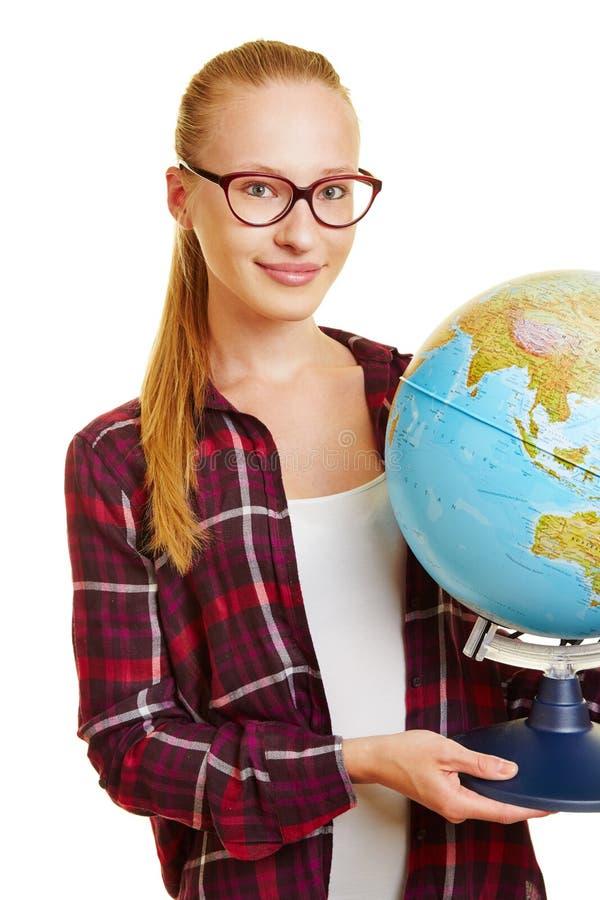 运载地球的少妇 免版税图库摄影