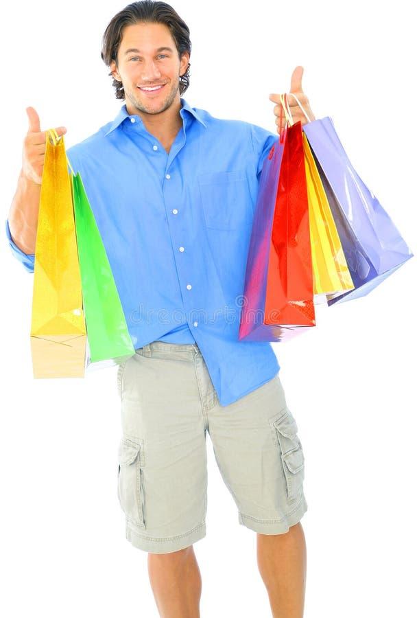 运载愉快的人购物年轻人的袋子 图库摄影