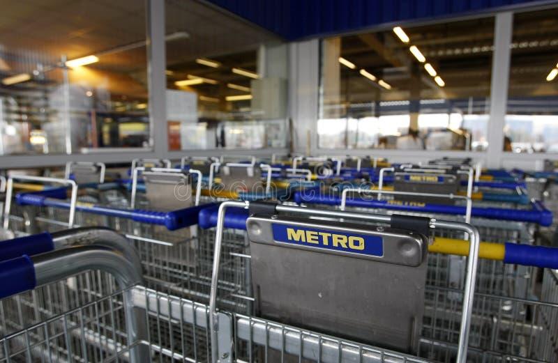 运载购物车现金徽标地铁超级市场 免版税图库摄影