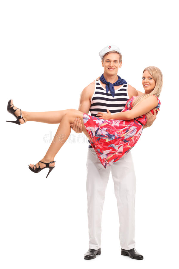 运载他的女朋友的年轻男性水手 免版税库存图片