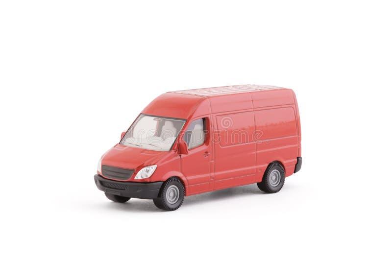 运输在白色背景的红色van car 免版税库存图片