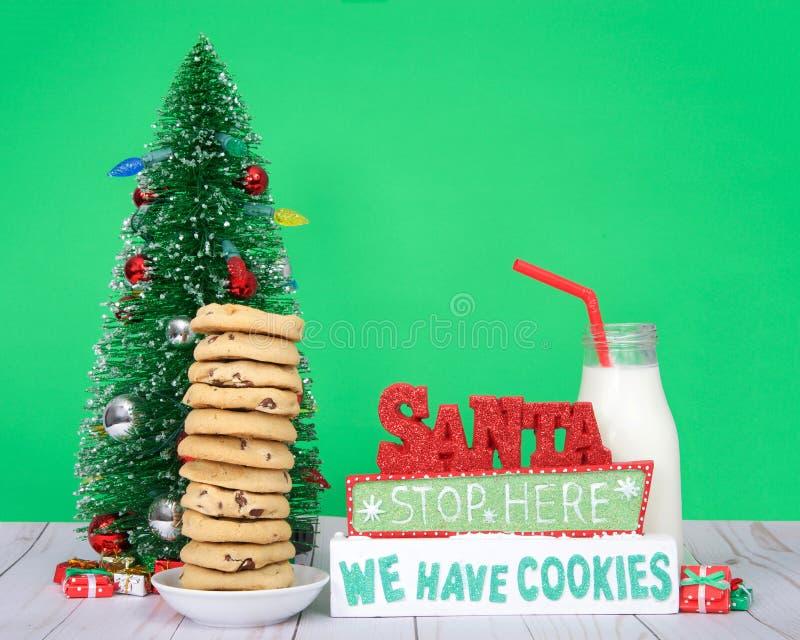 这里圣诞老人中止我们食用曲奇饼用巧克力曲奇饼 图库摄影