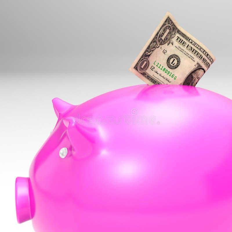 进入Piggybank的美元显示储款 库存图片