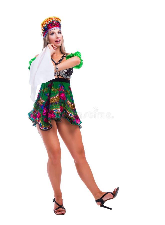 进行俄国传统民间舞的舞蹈家 库存图片