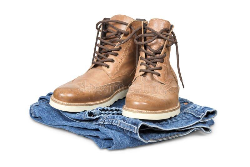 远足靴子和蓝色牛仔裤 库存图片