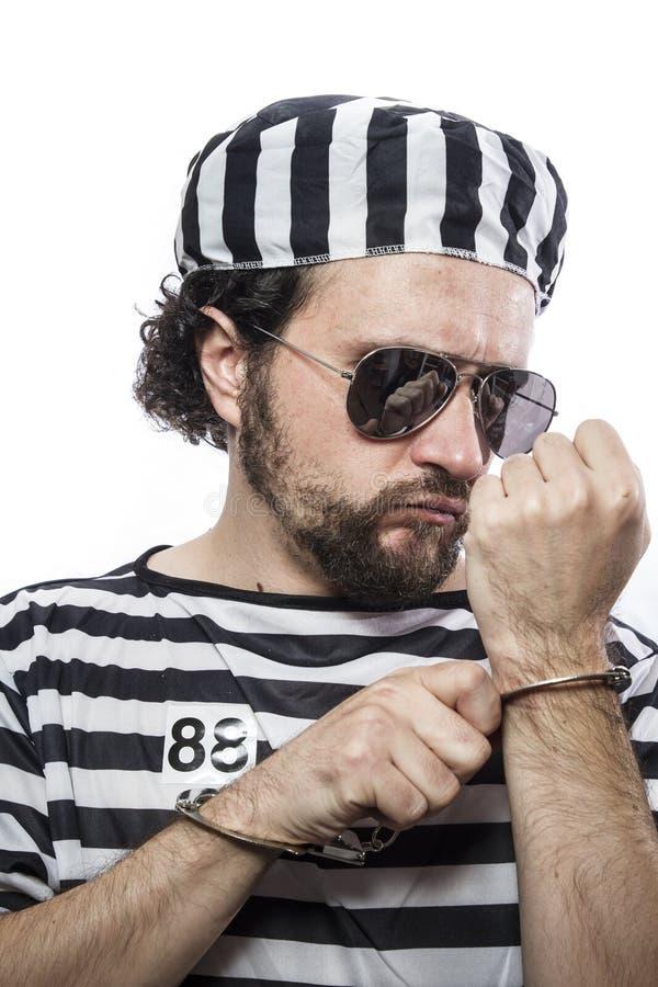 违法者,绝望,一个人囚犯的画象监狱服装的 免版税库存图片
