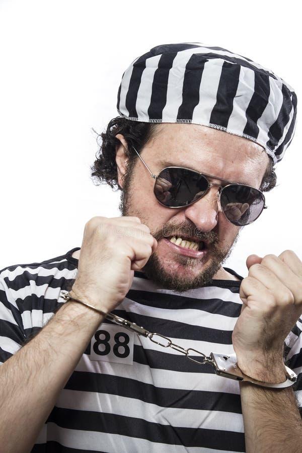 违法者,绝望,一个人囚犯的画象监狱服装的 库存照片