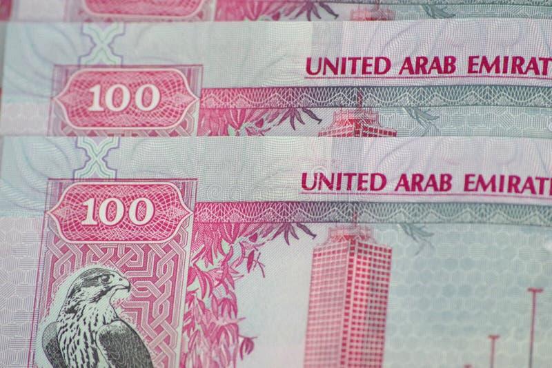 100迪拉姆特写镜头钞票,阿拉伯联合酋长国的正式货币 图库摄影