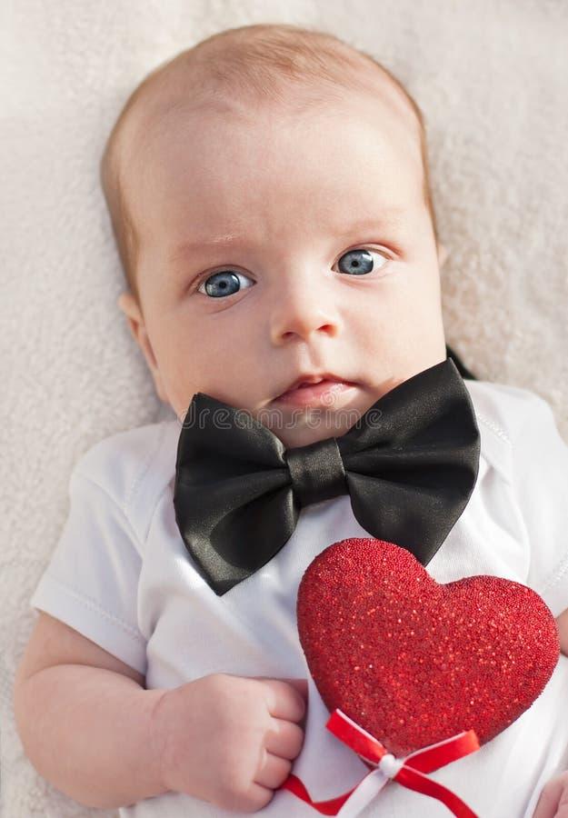 迷人的男婴绅士 库存图片