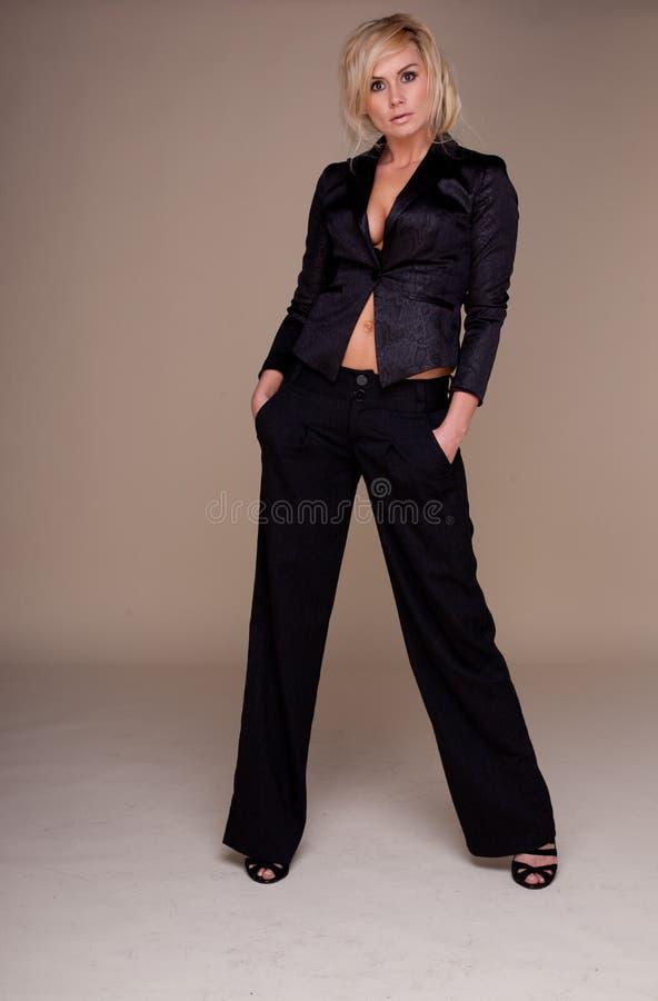 迷人的slacksuit妇女 图库摄影