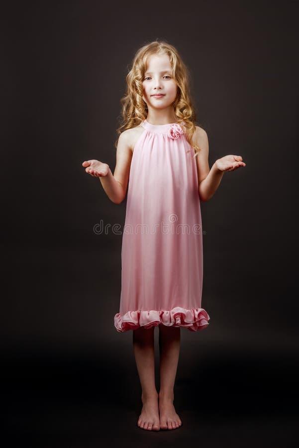 迷住相当小女孩礼服 库存照片