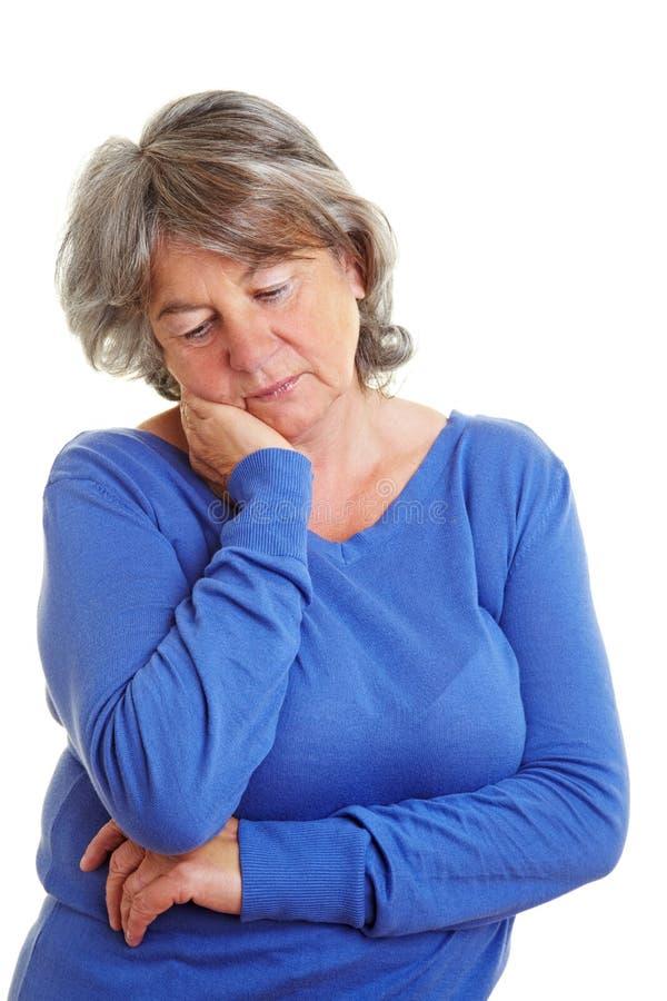 退休的哀伤的妇女 图库摄影