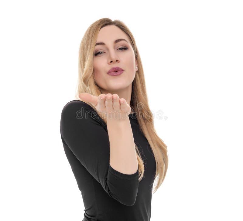 送空气亲吻的白肤金发的妇女 图库摄影