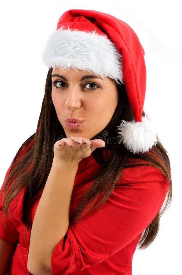送飞吻的圣诞老人帽子的少妇 库存图片