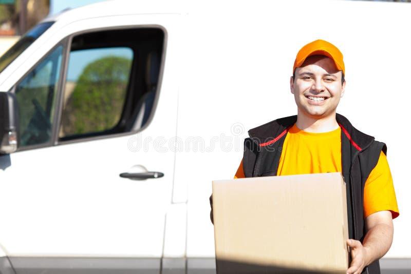 年轻送货人画象在工作 免版税图库摄影